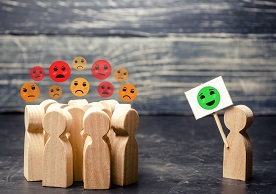 image of wooden block people exhibiting different facial expressions/attitudes