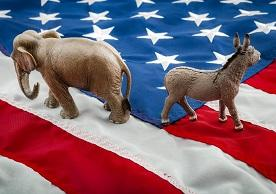 republican elephant and democrat donkey turning away from each other on a US flag background
