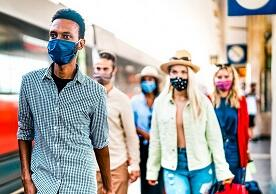 photo of masked travelers in an airport